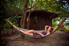 Donna in un hammock Immagine Stock