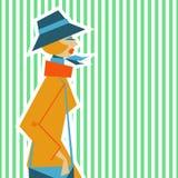 Donna in un retro stile del SIC 60 su un fondo verde chiaro Immagine Stock