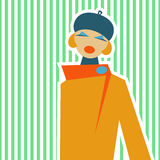 Donna in un retro stile del SIC 60 su un fondo verde chiaro Fotografia Stock