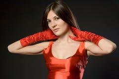 Donna in un rosso Immagini Stock Libere da Diritti