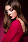 Donna in un vestito rosso Fotografia Stock