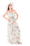Donna in un vestito su un fondo bianco Fotografia Stock
