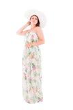 Donna in un vestito su un fondo bianco Fotografie Stock