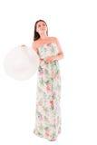Donna in un vestito su un fondo bianco Immagini Stock Libere da Diritti