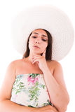 Donna in un vestito su un fondo bianco Immagine Stock