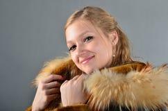 Donna in una pelliccia Fotografia Stock