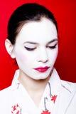 Donna vestita come geisha Fotografie Stock Libere da Diritti