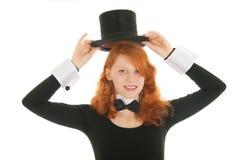 Donna vestita per il partito che elimina cappello Immagini Stock Libere da Diritti