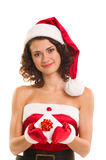 Donna in vestiti del Babbo Natale con il regalo Immagine Stock Libera da Diritti