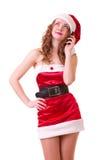 Donna in vestiti del Babbo Natale con il telefono Fotografie Stock Libere da Diritti