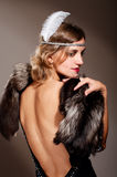 Donna in vestito e pelliccia da sera Fotografia Stock Libera da Diritti
