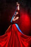 Donna in vestito rosso Fotografie Stock