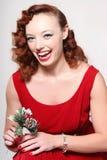 Donna in vestito rosso con il vischio Fotografia Stock Libera da Diritti