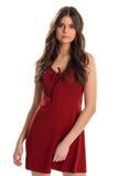 Donna in vestito rosso dal buco della serratura Fotografia Stock