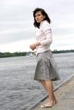 Donna vicino al fiume Immagine Stock Libera da Diritti