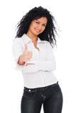 Donna vivace che mostra i pollici in su Immagini Stock