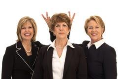 Donne allegre di affari Immagini Stock