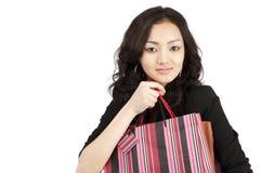 Donne asiatiche con i sacchetti di acquisto, isolati Fotografia Stock