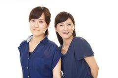 Donne asiatiche sorridenti fotografia stock libera da diritti