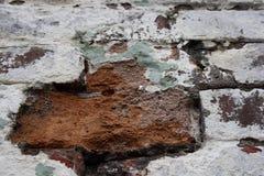 Donne au mur une consistance rugueuse de la brique photographie stock libre de droits