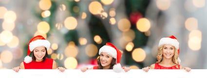 Donne in cappello dell'assistente di Santa con il bordo bianco in bianco Immagine Stock Libera da Diritti