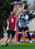 Donne che giocano lacrosse Fotografie Stock