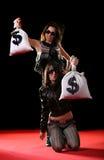 Donne con i sacchetti dei soldi Fotografia Stock Libera da Diritti