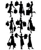 Donne con i sacchetti di acquisto Immagini Stock