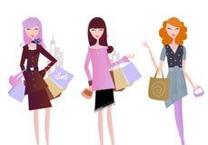Donne con i sacchetti di acquisto isolati su bianco Fotografia Stock
