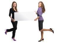 Donne con il tabellone per le affissioni Fotografie Stock