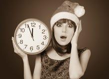 Donne con l'orologio enorme Immagini Stock