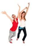 Donne con le braccia alzate Immagine Stock