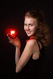 Donne di fascino con il gemito su fondo nero Fotografie Stock