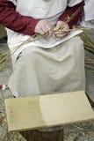 Donne di tessitura del grano Fotografia Stock