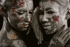 Donne dipinte con trucco immagini stock