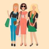 Donne nell'abbigliamento alla moda e nell'acquisto Immagine Stock Libera da Diritti