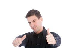 Donner d'homme bel des pouces lèvent le geste Images stock