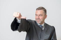 Donner d'homme d'affaires pouces au geste latéral Photos stock