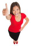 Donner heureux de femme des pouces lèvent le geste Photo stock