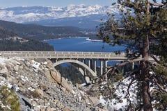 Donner Lake in the Sierra Nevada Range. Donner Lake and the old Highway 40 Bridge in the Sierra Nevada Range Stock Photo