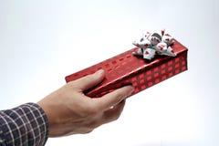 Donner un présent Photo stock