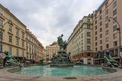 Donnerbrunnen is a Baroque fountain Stock Photos