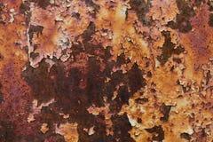 Donnez à beaucoup de couleur une consistance rugueuse rouge et orange rouillée en métal Photographie stock libre de droits