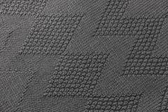 Donnez à la texture une consistance rugueuse grise de chandail photographie stock libre de droits