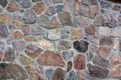 Donnez à la vieille brique ou au mur une consistance rugueuse en pierre fait en fond de pavés ronds Image libre de droits