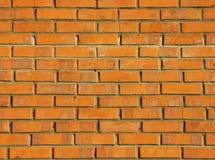 Donnez au mur de briques une consistance rugueuse Photos libres de droits