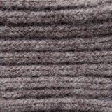 Donnez au tissu une consistance rugueuse tricoté Attache faciale pour le produit Tissu tricoté chaud de coton texturisé Texture p images libres de droits