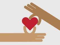 Donnez et obtenez le concept de coeur à la main pour l'amour Photo stock