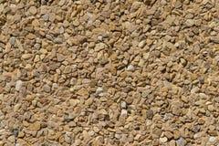 Donnez pierres une consistance rugueuse de petits morceaux de wallcovering de mur en pierre aux différentes Photo stock