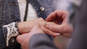 Donning wedding ring groom. Two white people groom and bride exchange wedding rings stock footage